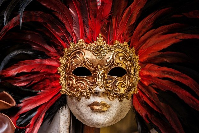 Picture of a Carnival mask - gold plate with bright red feathers