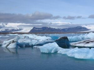 Icelandic glacial ice flows with the mountains in the background