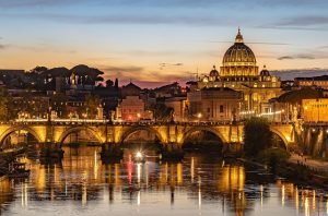 Picture of Rome with a gloden glow reflecting in the water as the evening starts