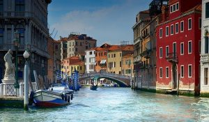 Picture of gondolas, bridges and traffic on the canals in Venice Italy