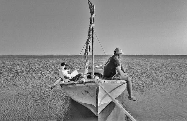Picture of a biatman resting on a boat on Qaroun Lake in Egypt
