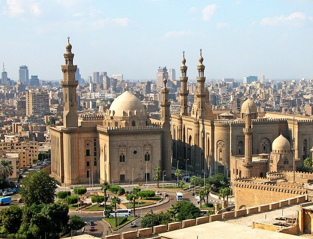 Picture of the city of Cairo with a large mosque dominating the scene