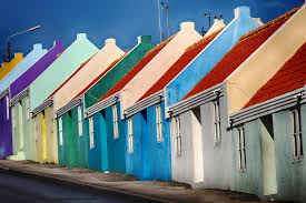 Brightly colored buildings line the walkway in Curacao
