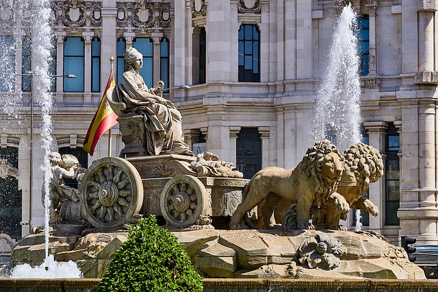 Historic statues are everywhere in Madrid Spain. This one shows a  VIP in an open carriage pulled by lions