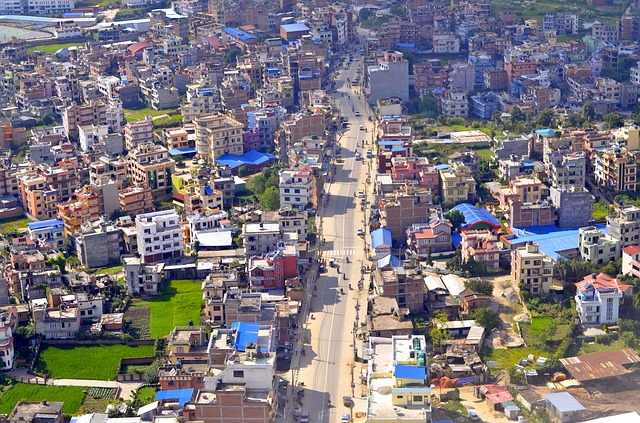 Picture of a Kathmandu Nepal cityscape with bright blue roofs scattered through the city