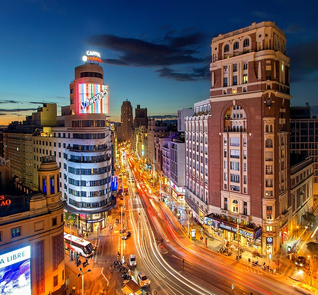 The streets light up at night in Madrid Spain