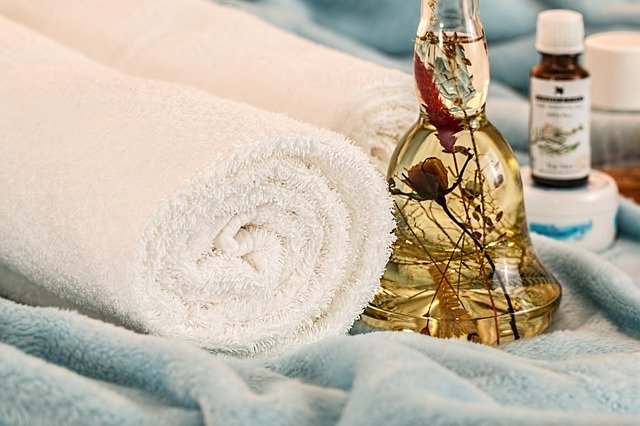 Spalike picture of towels with essential and massage oils