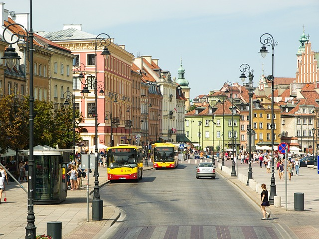 The city streets bustle with energy amid period architecture in Warsaw Poland