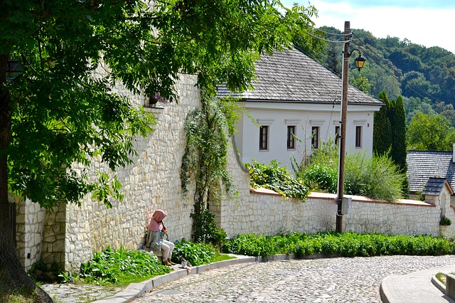 Stone walls and cobbled roads along the way by Raclawice in Poland