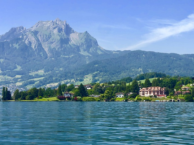 Mount Pilatus rises in the distance as you stream across the waters of Lake Lucerne