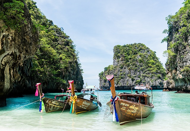 Picture of traditional canoes on the water near Phuket Thailand