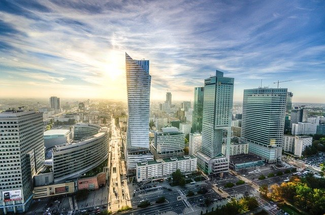 The Warsaw skyline stands bright and vibrant against a wispy blue sky