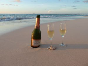 You might enjoy a bottle of wine on the beach while visiting Aruba