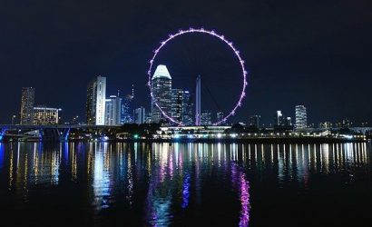 Picture of the Ferris Wheel lighting the night sky in Singapore