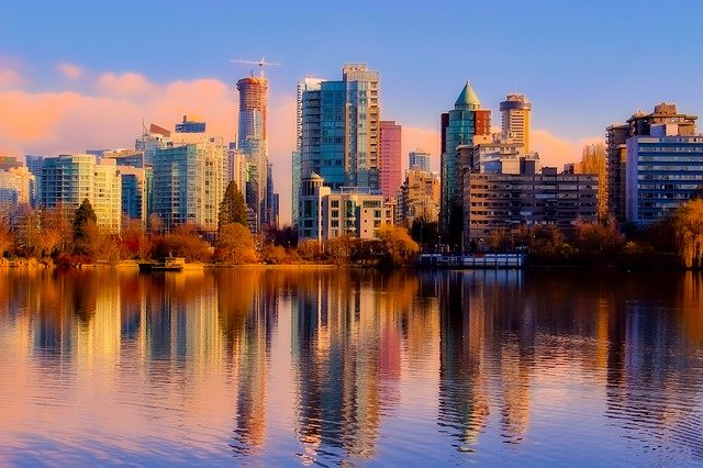 Beatiful fall colors reflected in the water show off Vancouver's downtown skyline